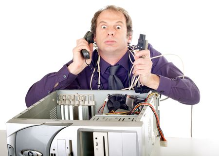 malfunction: furious businessman having computer problems trying to call hotline Stock Photo