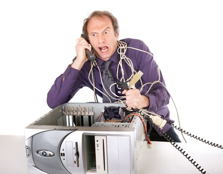 angry businessman having computer problems and phoning support photo