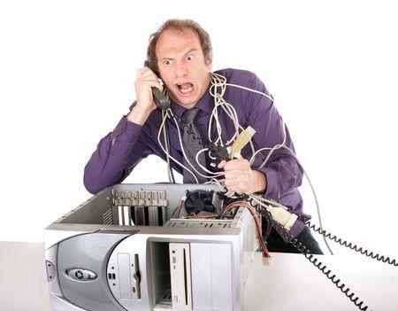empresario enojado: enojado empresario tenga problemas con su ordenador y tel�fono de apoyo Foto de archivo