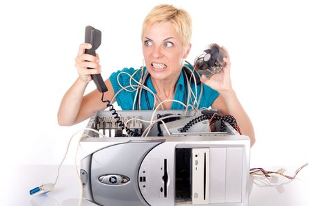 blond woman having problem with computer yelling at support on phone photo