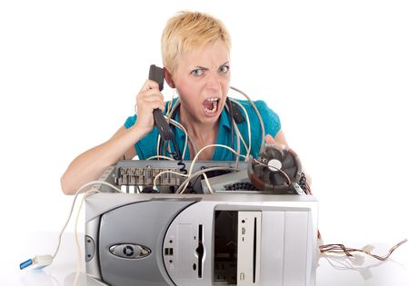 woman having problem with computer calling support on phone  photo