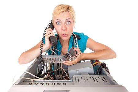 upset blond woman having problems with computer phoning support  photo