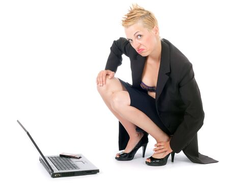 dynamic punk rock business woman with laptop and cellphone isolated photo