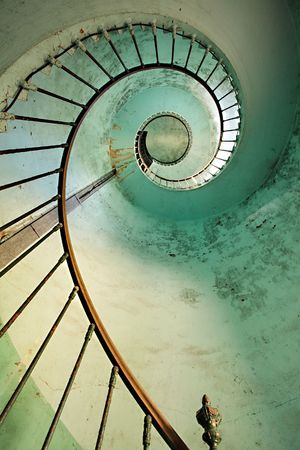 dynamic view on old hourtin lighthouse spiral staircase, france photo