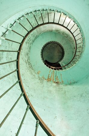 vertical view of hourtin lighthouse spiral staircase, france photo