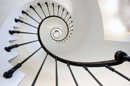 spirals: wide angle view of Grave lighthouse staircase, france, gironde Stock Photo
