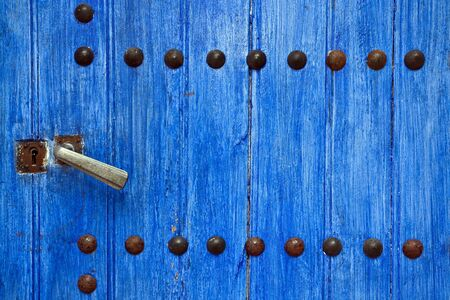 closeup on studded blue wooden door Stock Photo - 5253220