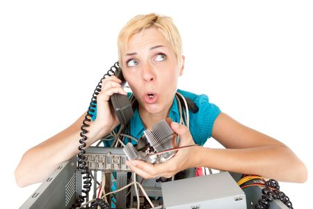 malfunction: confused woman phoning technology support for computer Stock Photo