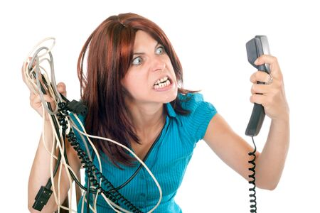 malfunction: red hair woman very upset against technology Stock Photo