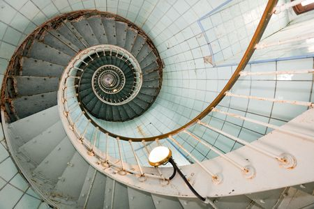 spiral stairway: dynamic view of la coubre lighthouse high staircase, france Stock Photo