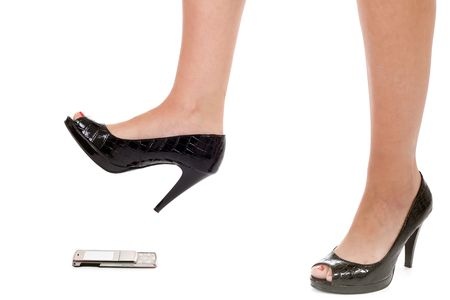 crush: woman foot crushing cellular phone isolated on white Stock Photo