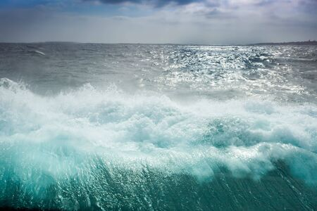 ocean wave, view from boat window with drops on glass Stock Photo