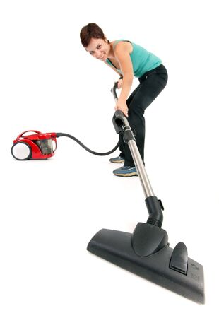 dynamic view of woman with vacuum cleaner isolated on white, focus on brush Stok Fotoğraf