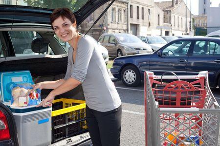 customer woman loading car with food at supermarket car park Stock Photo - 5654337