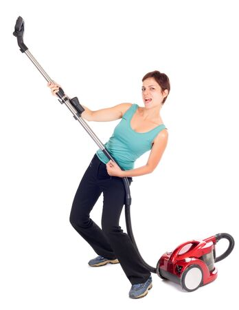 woman playing guitar with vacuum cleaner isolated on white photo