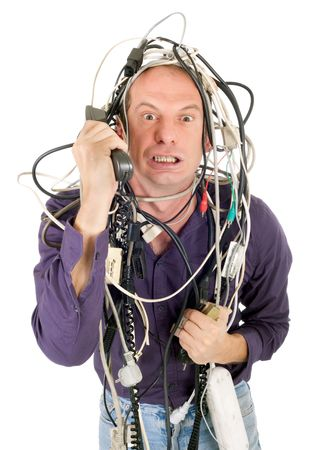 cable tangle: furious man tangled with electric cables phoning technology support