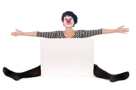 cheerful clown woman seated on floor and presenting white billboard Stock Photo - 5948371