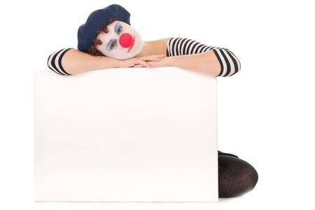 Young woman wearing clown face holding billboard isolated on white photo