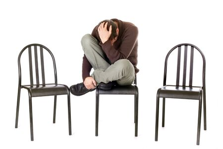 sad and alone man sitting on chair isolated on white