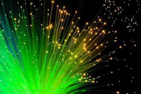 illuminated decorative green optic fibers under black background photo