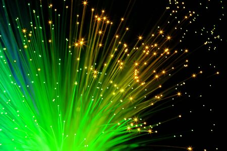 illuminated decorative green optic fibers under black background photo