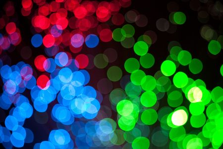 colorful defocused christmas lights under black background Stock Photo - 6166521