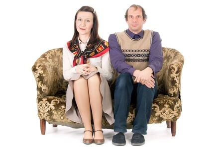 bored woman: bored  old looking couple sitting on vintage couch isolated on white