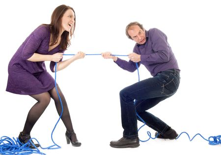 husband and wife in conflict pulling blue rope over white background photo