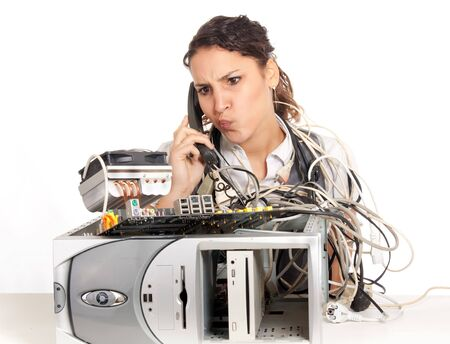 computer support: young business woman calling technology support for the broken computer Stock Photo