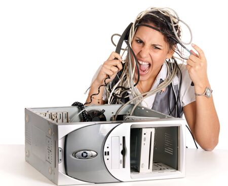 computer cable: young angry woman having problems with computer and phoning helpline