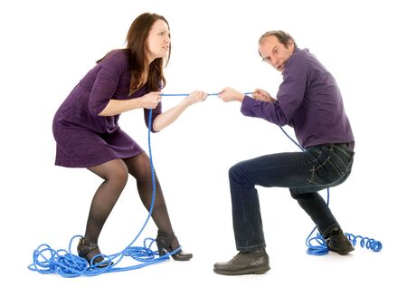 pulling beautiful: mature couple fighting together pulling rope isolated on white