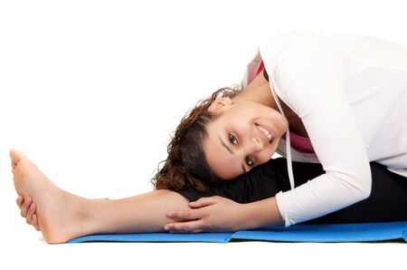 portrait of woman doing stretching exercises isolated on white photo