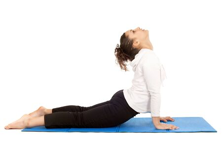teenager stretching body on exercise mat isolated on white photo