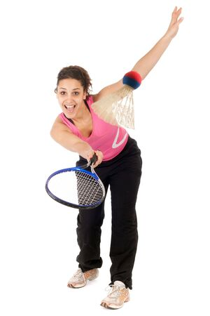 young woman playing badminton isolated on white background photo