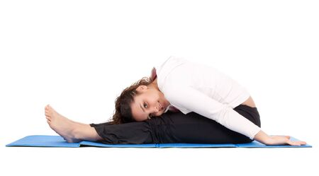 flexible young woman stretching body on exercise mat photo