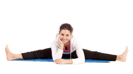 young woman doing the splits on exercise mat photo
