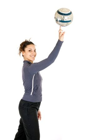 young soccer woman making ball rolling on finger Standard-Bild