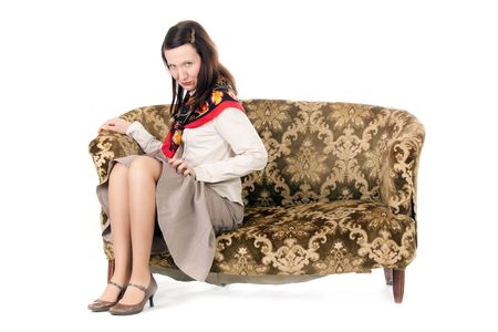 enticing: kitsch mature woman enticing on old fashioned sofa