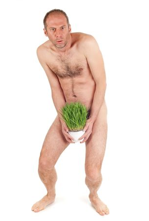 nude man hiding penis with grass flowerpot isolated on white