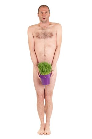 nude man standing and holding grass flowerpot isolated on white Stock Photo