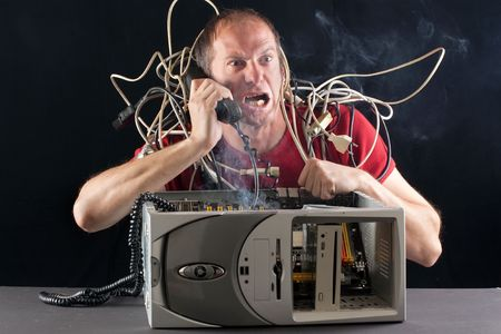out of order: man having his computer burning phoning technical support for help Stock Photo