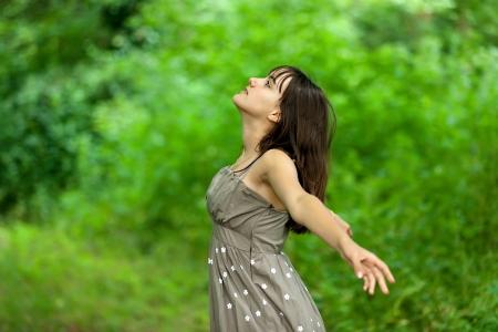 teenager girl breathing in fresh green nature Stock Photo