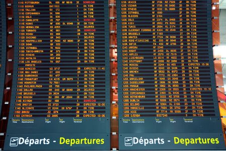 delay: large plane departure board at paris airport