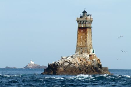 beacon: la vieille and tevennec lighthouses in brittany sea, france