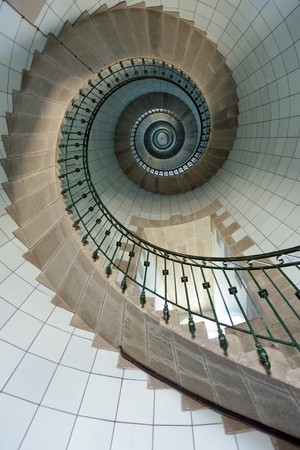 dynamic view of high lighthouse staircase, 392 steps, vierge island, brittany,france