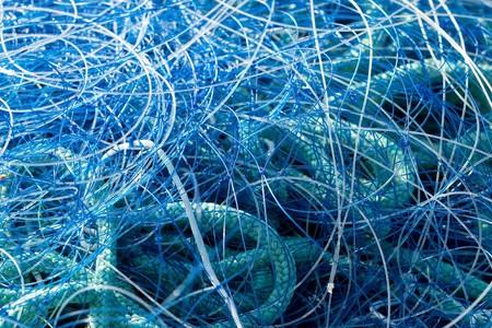 blue fishing net closeup in maritime harbor Stock Photo - 7812706