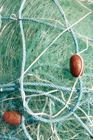 blue fishing net, rope and buoys closeup Stock Photo - 7812705