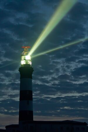 creach lighthouse at night on ouessant island, brittany, france