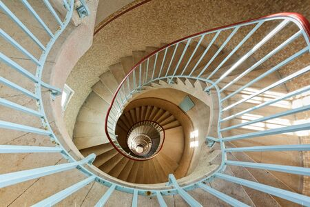 granite lighthouse staircase going down, sein island, brittany, france photo