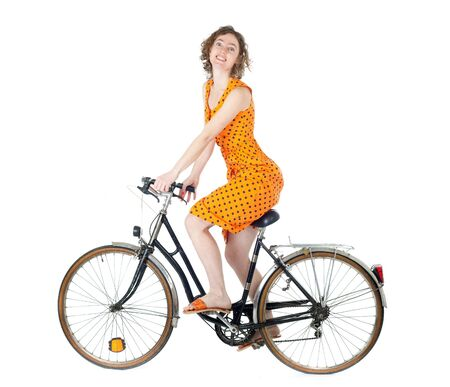 bicycling: happy young woman riding bicycle isolated on white background
